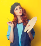 Girl with palette and brush Royalty Free Stock Images
