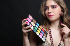 Girl with a palette of shadows Stock Photography