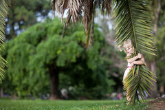 Girl with a palm leaf Royalty Free Stock Image