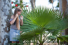 Girl and palm Royalty Free Stock Image