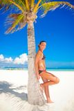 Girl by palm tree Royalty Free Stock Photography