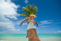 Girl on a palm tree Royalty Free Stock Image