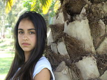 Girl by the Palm tree Royalty Free Stock Images