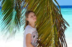The girl with palm tree Royalty Free Stock Images