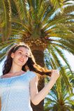 Girl and palms. A white girl at the summer nature royalty free stock images