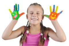 Girl with the palms painted by a paint. Stock Image