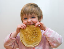 The girl with a pancake Royalty Free Stock Photo