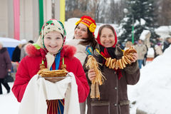 Girl with pancake during  Shrovetide Stock Image