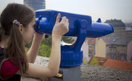 Girl with a panorama telescope Stock Photo