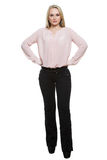Girl in pants and blous.  Isolated on white. Background. body language Stock Image
