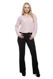 Girl in pants and blous. Isolated on white. Background. body language stock photo