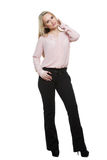 Girl in pants and blous. Isolated on white. Background. body language royalty free stock image