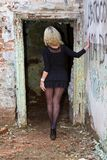 Girl in pantyhose. Walks around the ruined house Royalty Free Stock Images