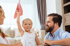 Girl with paper airplane Royalty Free Stock Image