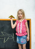 Girl with paper airplane Stock Photos