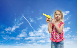 Girl with paper airplane Royalty Free Stock Photos