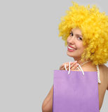 Girl with paper bag. Happy girl with paper bag Royalty Free Stock Images