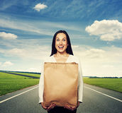 Girl with paper bag at outdoor Royalty Free Stock Photography