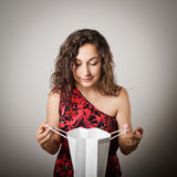 Girl and paper bag. Royalty Free Stock Photo
