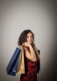 Girl and paper bags. Royalty Free Stock Images