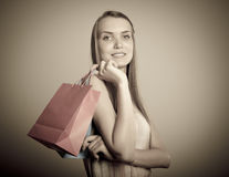 Girl and paper bags. Stock Image