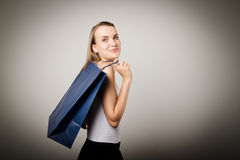 Girl and paper bags. Stock Photography
