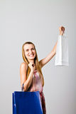 Girl and paper bags. Royalty Free Stock Photos