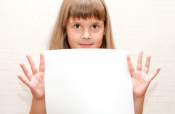Girl with paper A4. Girl with blank paper A4 in her hands Royalty Free Stock Photography