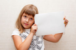 Girl with paper A4. Girl with blank paper A4 in her hands Royalty Free Stock Image