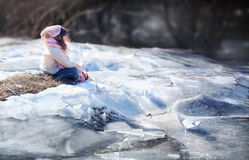 Girl with paper boat. Near winter river Stock Photography