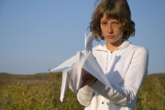 Girl with paper crane Stock Photography