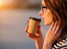 Girl with a paper cup Stock Photography