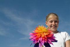 Girl with a paper flower Stock Photo