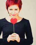 Girl with paper heart Stock Photography