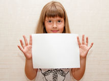 Girl with paper A4. In her hands Royalty Free Stock Photo