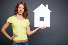 Girl with paper house Stock Photos