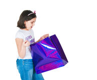 Girl with paper packages Royalty Free Stock Photography