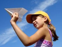 Girl with paper plane Stock Image