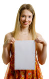 Girl with paper sheet. Girl with a white sheet of paper for a slogan Stock Images