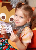 The girl with a paper snowflake Royalty Free Stock Image