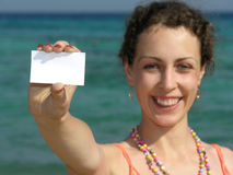 Girl with paper for text on beach Royalty Free Stock Images