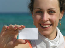 Girl with paper for text on beach Stock Photography