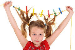 Girl with paperclips in hair Royalty Free Stock Photography