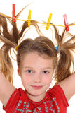 Girl with paperclips in hair Stock Photography
