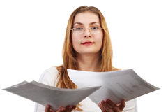 Girl with papers. Young girl with sheets of paper in her hands Royalty Free Stock Images