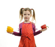 Girl with paprika Stock Image