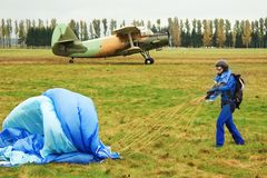 Girl, parachute and aircraft Royalty Free Stock Photos