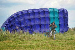 Girl with a parachute after landing Stock Photo