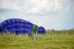 Girl with a parachute after landing Royalty Free Stock Image