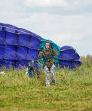 Girl with a parachute after landing Royalty Free Stock Photography